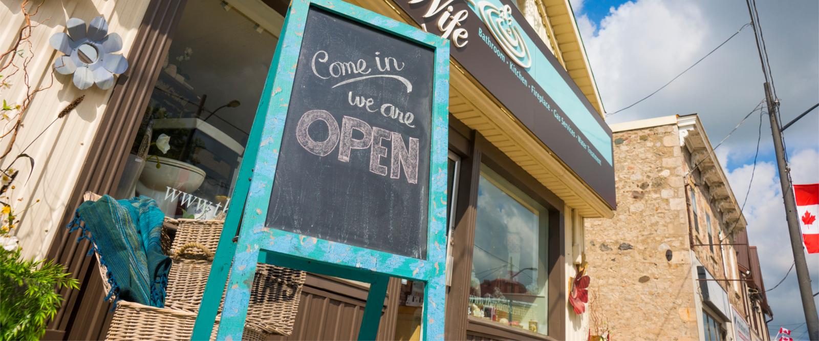 Sandwich board sign We're Open