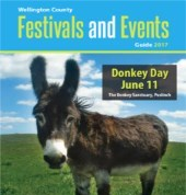festivals and events magazine cover featuring donkey day