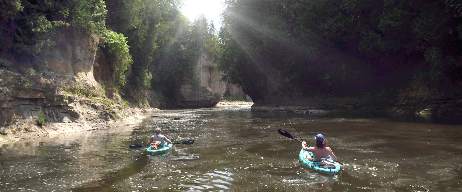 two people kayaking the Grand River