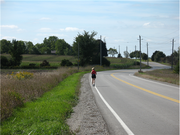 Jogger along side of road in Wellington County