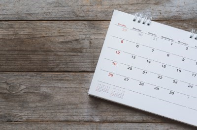 calendar laying on barn board