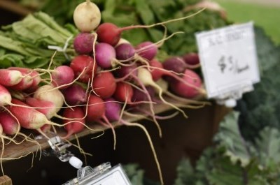 pile of radishes on wooden box