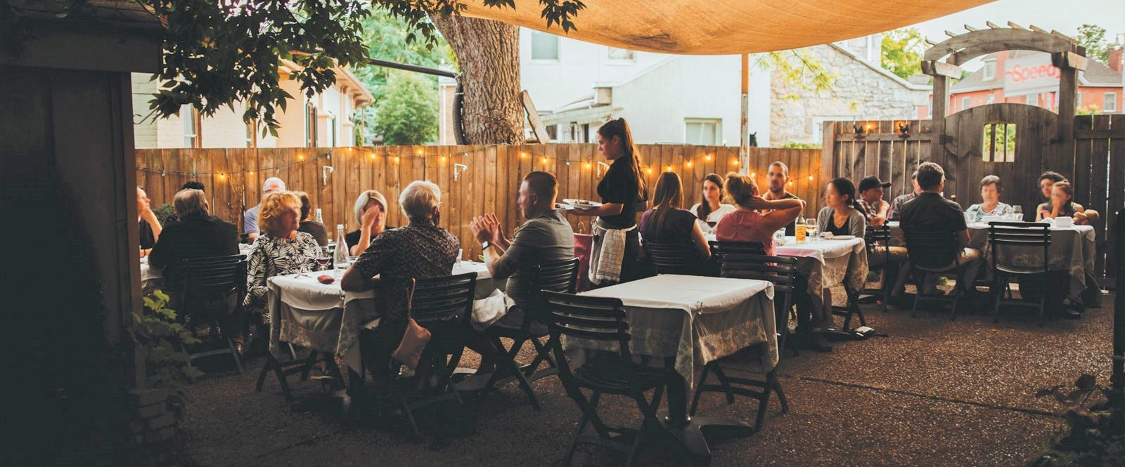 outside restaurant patio with people eating