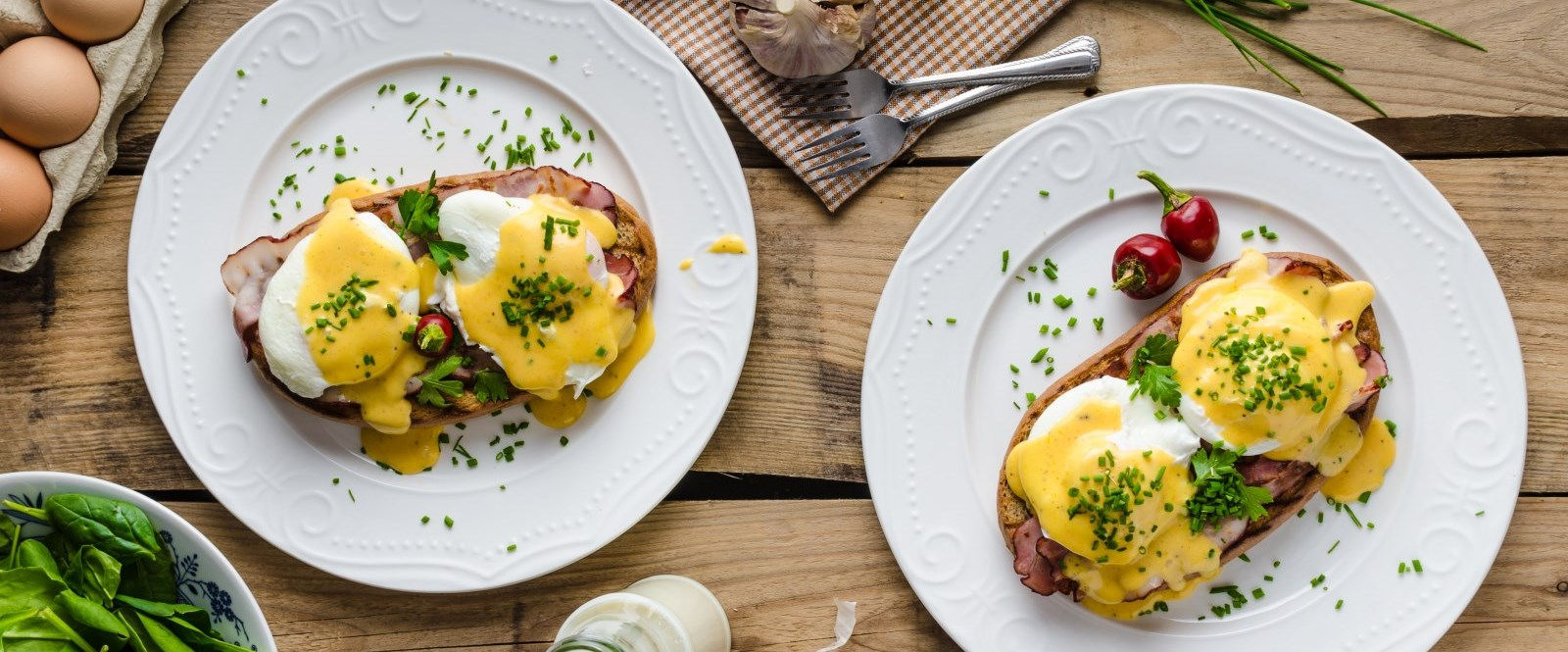 two plates of eggs benedict