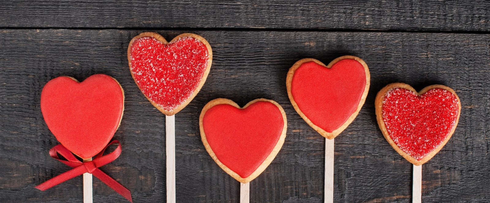 close up of heart shaped sugar cookie pops