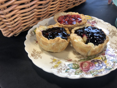 lemon custard tarts with fresh berry compte on a plate