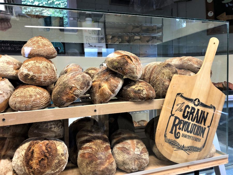 artisan bread in a glass display case