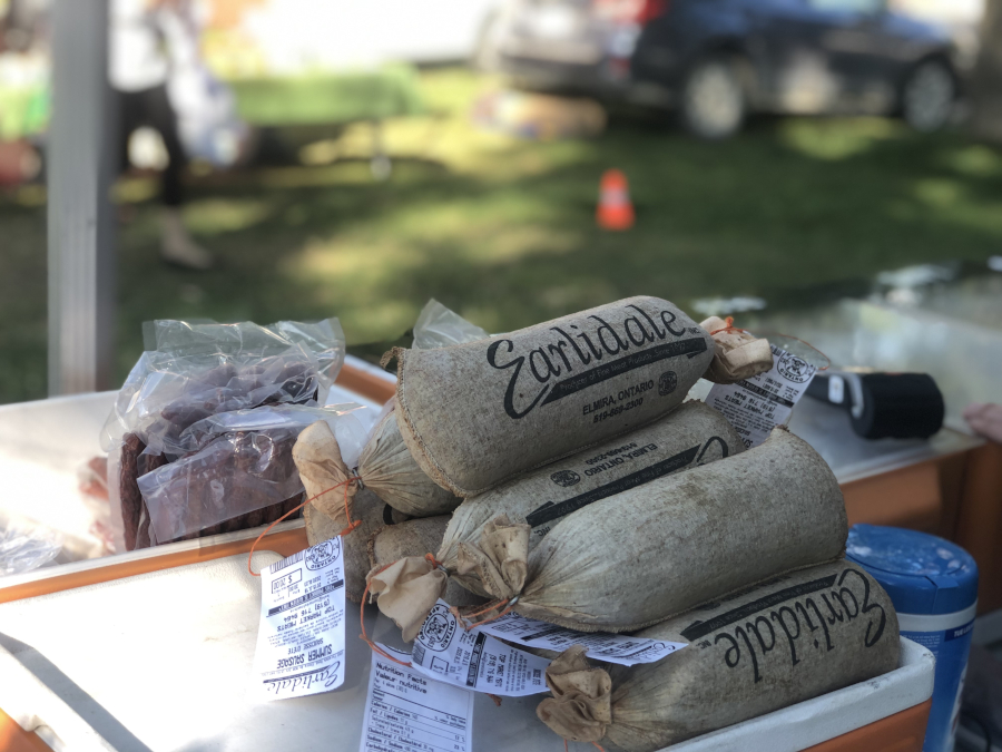 wrapped summer sausage piled on a cooler