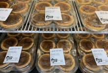 butter tarts in a display case wrapped up
