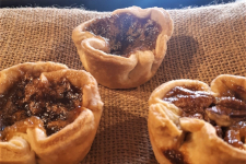 three butter tarts placed on burlap