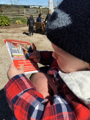 boy holding fall rural romp map