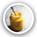 jar of mustard with spoon