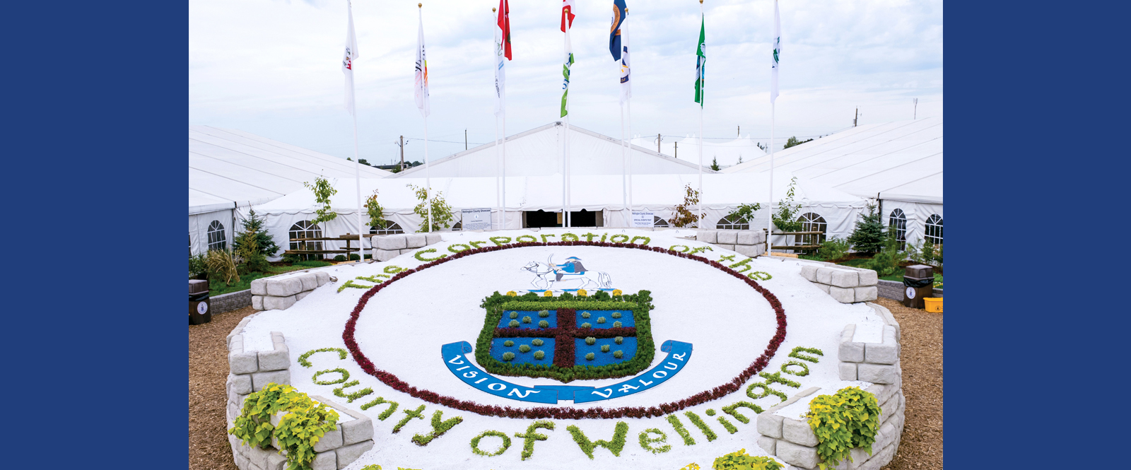 Wellington County logo with Town and Township flags