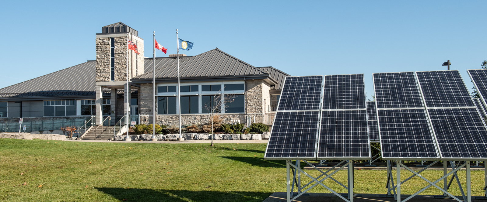 County building with large solar panels on property