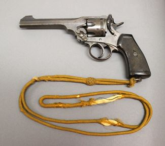1917 revolver with gold lanyard