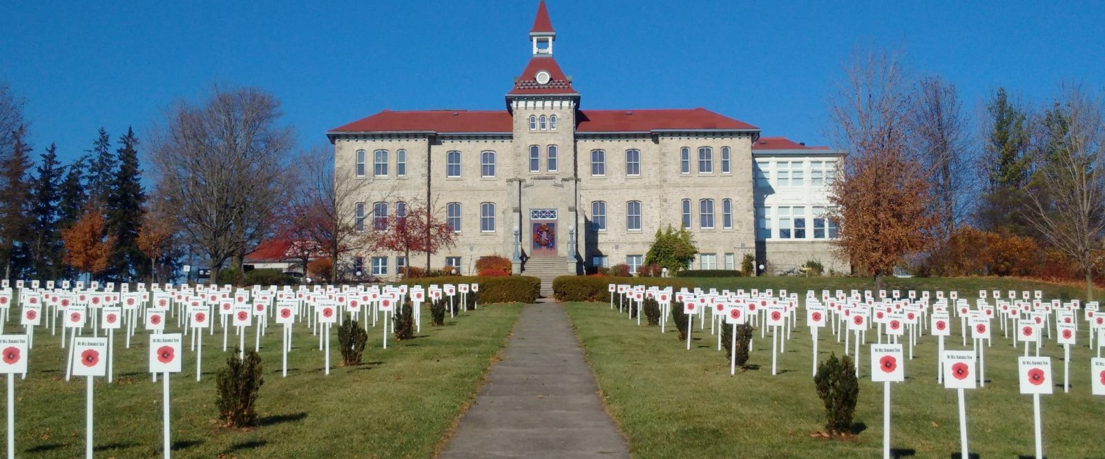 Front of Museum building with remembrance crosses