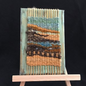 Small tapestry on small easle