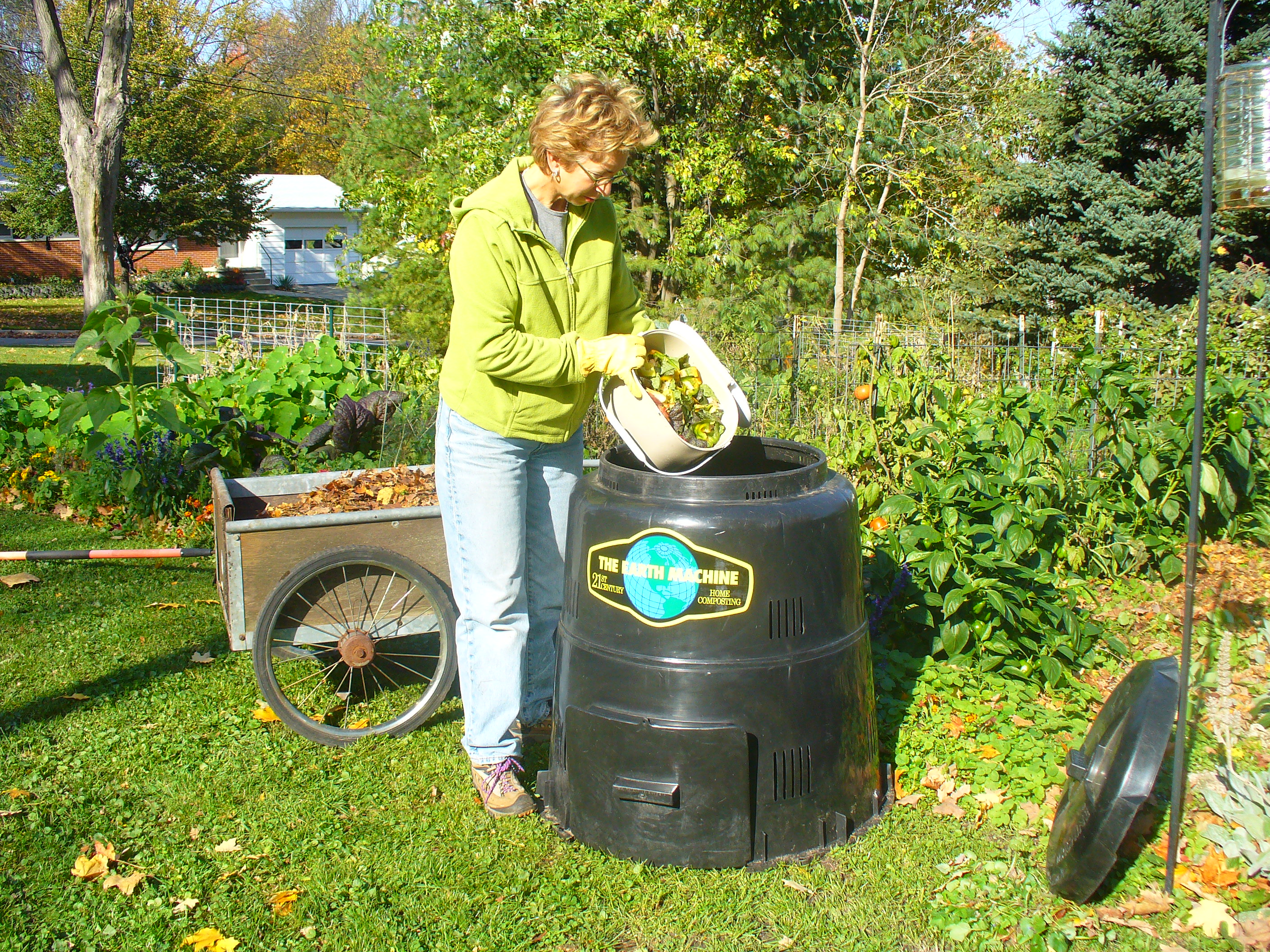 resident disposing organic waste in Earth Machine composter