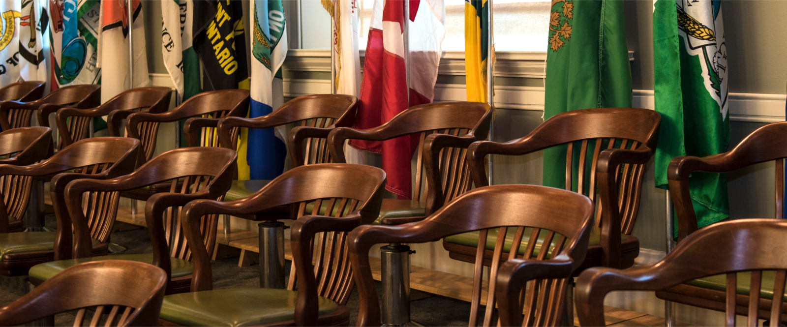 Wooden armchairs and municipal flags